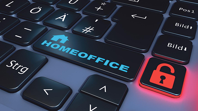 Computertastatur mit einer Taste, die mit Homeoffice beschriftet ist und einer mit einem Schloss